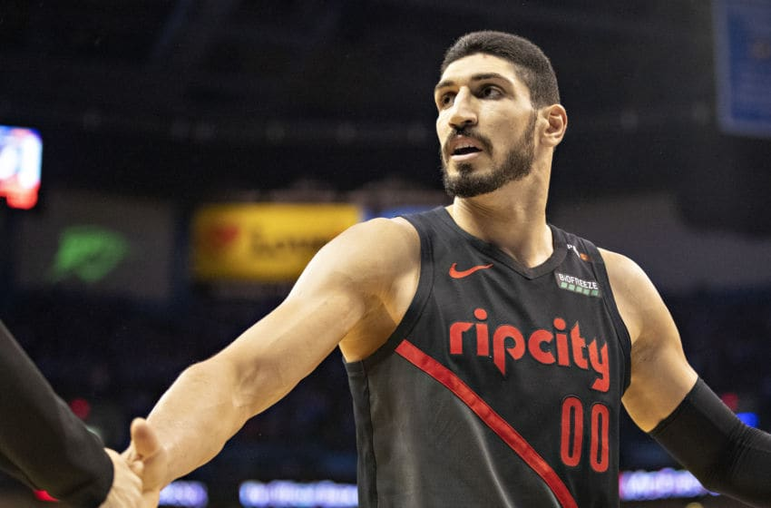 OKLAHOMA CITY, OK - APRIL 21: Enes Kanter #00 of the Portland Trail Blazers is congratulated after scoring and drawing a foul during a game against the Oklahoma City Thunder during Round One Game Three of the 2019 NBA Playoffs on April 21, 2019 at Chesapeake Energy Arena in Oklahoma City, Oklahoma NOTE TO USER: User expressly acknowledges and agrees that, by downloading and or using this photograph, User is consenting to the terms and conditions of the Getty Images License Agreement. The Trail Blazers defeated the Thunder 111-98. (Photo by Wesley Hitt/Getty Images)