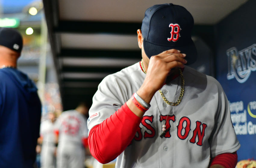 ST. PETERSBURG, FLORIDA - APRIL 20: Mookie Betts #50 of the Boston Red Sox puts on his hat during the second inning against the Tampa Bay Rays at Tropicana Field on April 20, 2019 in St. Petersburg, Florida. (Photo by Julio Aguilar/Getty Images)