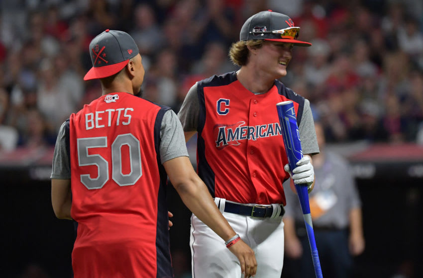 CLEVELAND, OHIO - JULY 08: Blaze Jordan reacts with Mookie Betts of the Boston Red Sox during the T-Mobile Home Run Derby at Progressive Field on July 08, 2019 in Cleveland, Ohio. (Photo by Jason Miller/Getty Images)