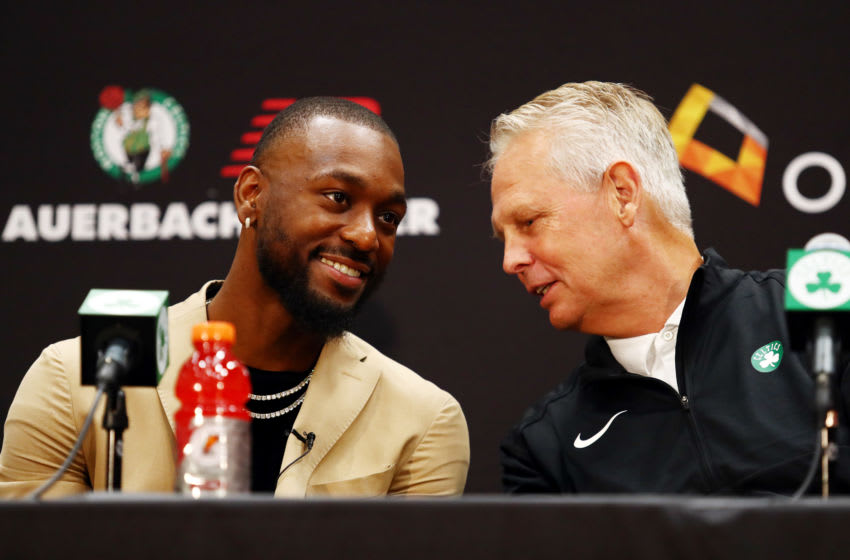 BOSTON, MASSACHUSETTS - JULY 17: Kemba Walker talks with Celtics President of Basketball Operations Danny Ainge during a press conference as he is introduced as a member of the Boston Celtics at the Auerbach Center at New Balance World Headquarters on July 17, 2019 in Boston, Massachusetts. (Photo by Tim Bradbury/Getty Images)