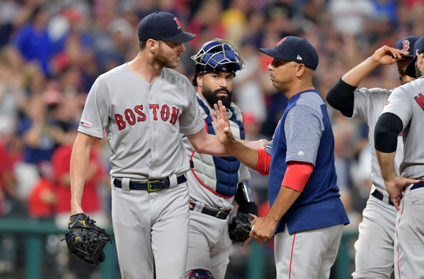 CLEVELAND, OHIO - AUGUST 13: Starting pitcher Chris Sale #41 is removed from the game by manager Alex Cora #20 of the Boston Red Sox during the seventh inning against the Cleveland Indians at Progressive Field on August 13, 2019 in Cleveland, Ohio. (Photo by Jason Miller/Getty Images)