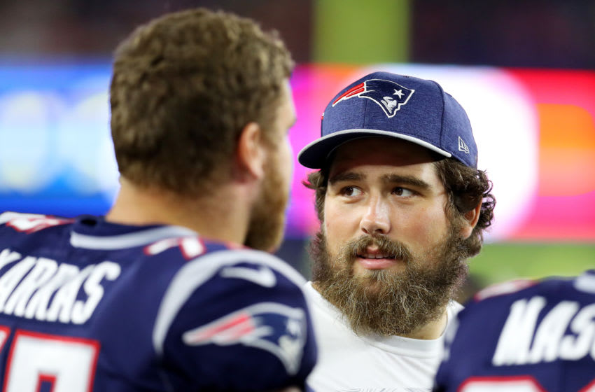 FOXBOROUGH, MASSACHUSETTS - AUGUST 29: David Andrews #60 of the New England Patriots talks to teammates on the sideline during the preseason game between the New York Giants and the New England Patriots at Gillette Stadium on August 29, 2019 in Foxborough, Massachusetts. (Photo by Maddie Meyer/Getty Images)