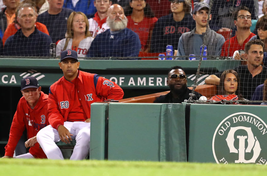 BOSTON, MASSACHUSETTS - SEPTEMBER 09: Boston Red Sox manager Alex Cora sits in the dugout next to David Ortiz and his wife Tiffany during the first inning of the game between the Boston Red Sox and the New York Yankees at Fenway Park on September 09, 2019 in Boston, Massachusetts. (Photo by Maddie Meyer/Getty Images)