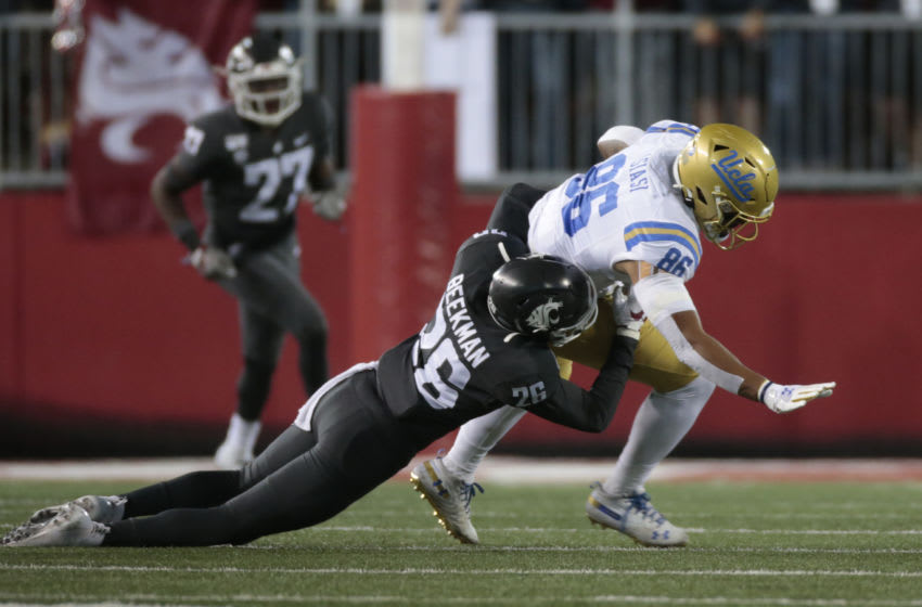 PULLMAN, WASHINGTON - SEPTEMBER 21: Devin Asiasi #86 of the UCLA Bruins moves the ball against Bryce Beekman #26 of the Washington State Cougars in the first half at Martin Stadium on September 21, 2019 in Pullman, Washington. UCLA defeats Washington State 67-63. (Photo by William Mancebo/Getty Images)