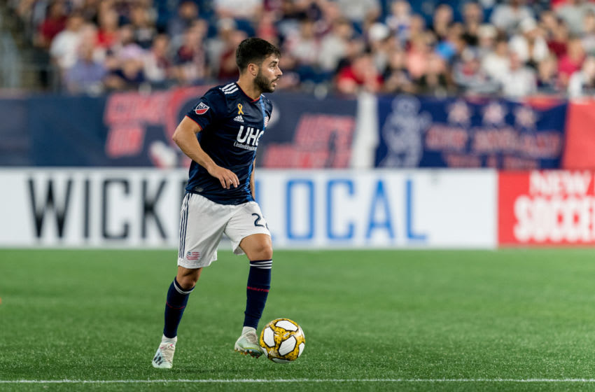 FOXBOROUGH, MA - SEPTEMBER 21: Carles Gil #22 of New England Revolution looks to pass during a game between Real Salt Lake and New England Revolution at Gillette Stadium on September 21, 2019 in Foxborough, Massachusetts. (Photo by Andrew Katsampes/ISI Photos/Getty Images).