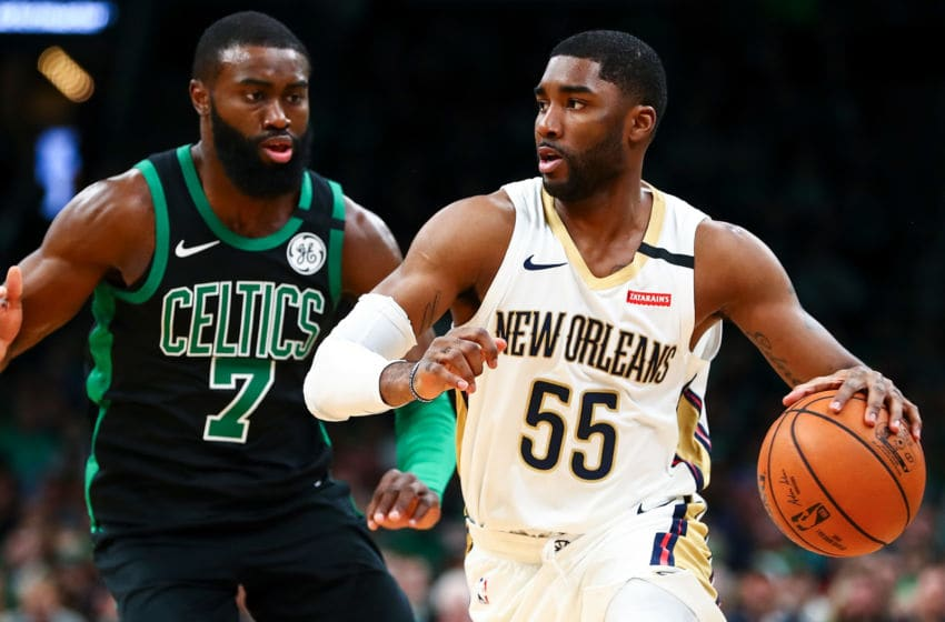 BOSTON, MA - JANUARY 11: Derrick Favors #22 of the New Orleans Pelicans dribbles the ball past Jaylen Brown #7 of the Boston Celtics during a game at TD Garden on January 11, 2019 in Boston, Massachusetts. NOTE TO USER: User expressly acknowledges and agrees that, by downloading and or using this photograph, User is consenting to the terms and conditions of the Getty Images License Agreement. (Photo by Adam Glanzman/Getty Images)