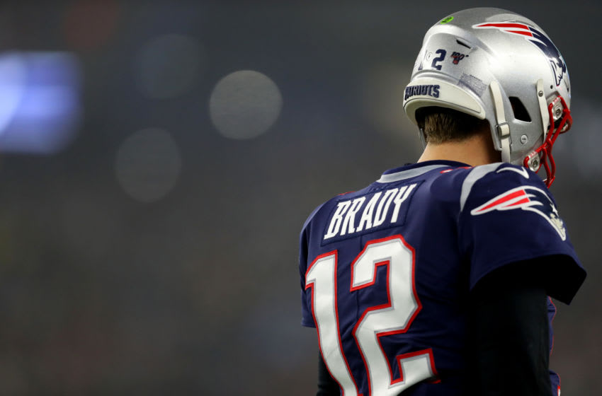 FOXBOROUGH, MASSACHUSETTS - JANUARY 04: Tom Brady #12 of the New England Patriots looks on during the the AFC Wild Card Playoff game against the Tennessee Titans at Gillette Stadium on January 04, 2020 in Foxborough, Massachusetts. (Photo by Maddie Meyer/Getty Images)