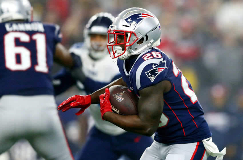 FOXBOROUGH, MASSACHUSETTS - JANUARY 04: Sony Michel #26 of the New England Patriots carries the ball in the AFC Wild Card Playoff game against the Tennessee Titans at Gillette Stadium on January 04, 2020 in Foxborough, Massachusetts. (Photo by Adam Glanzman/Getty Images)
