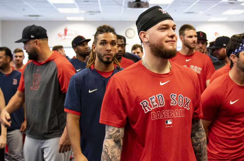FT. MYERS, FL - FEBRUARY 17: Alex Verdugo #99 of the Boston Red Sox reacts during a team meeting before a team workout on February 17, 2020 at jetBlue Park at Fenway South in Fort Myers, Florida. (Photo by Billie Weiss/Boston Red Sox/Getty Images)