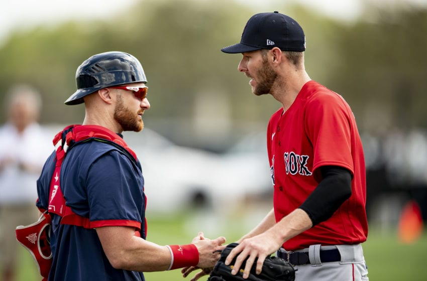 FT. MYERS, FL - FEBRUARY 20: Chris Sale #41 of the Boston Red Sox high fives Jonathan Lucroy #12 during a team workout on February 20, 2020 at jetBlue Park at Fenway South in Fort Myers, Florida. (Photo by Billie Weiss/Boston Red Sox/Getty Images)