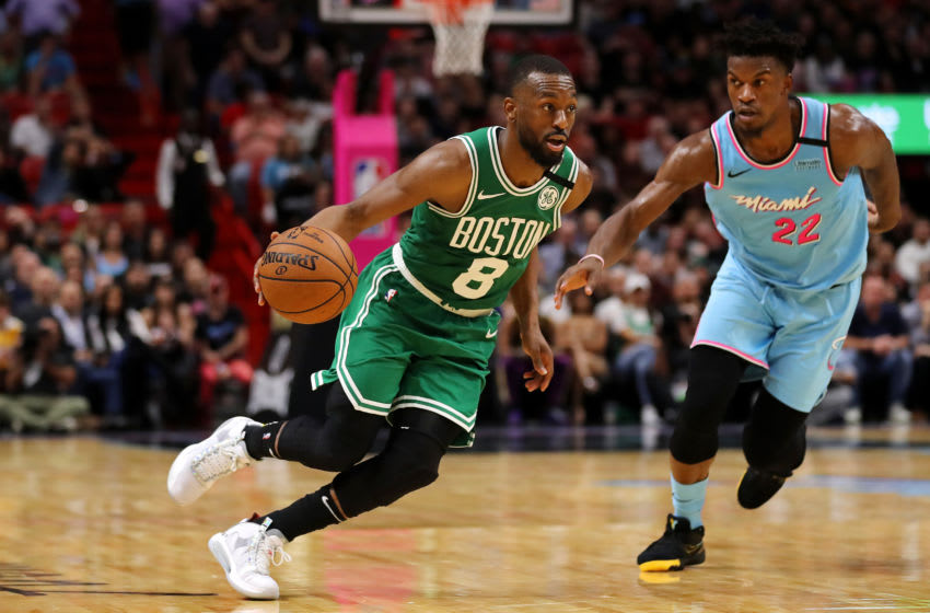 MIAMI, FLORIDA - JANUARY 28: Kemba Walker #8 of the Boston Celtics drives to the basket against Jimmy Butler #22 of the Miami Heat during the second half at American Airlines Arena on January 28, 2020 in Miami, Florida. NOTE TO USER: User expressly acknowledges and agrees that, by downloading and/or using this photograph, user is consenting to the terms and conditions of the Getty Images License Agreement. (Photo by Michael Reaves/Getty Images)