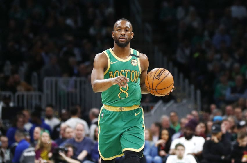 BOSTON, MASSACHUSETTS - JANUARY 30: Kemba Walker #8 of the Boston Celtics brings the ball up court during the third quarter of the game against the Golden State Warriors at TD Garden on January 30, 2020 in Boston, Massachusetts. NOTE TO USER: User expressly acknowledges and agrees that, by downloading and or using this photograph, User is consenting to the terms and conditions of the Getty Images License Agreement. (Photo by Omar Rawlings/Getty Images)