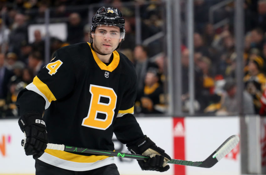 BOSTON, MASSACHUSETTS - FEBRUARY 15: Jake DeBrusk #74 of the Boston Bruins looks on during the first period of the game against the Detroit Red Wings at TD Garden on February 15, 2020 in Boston, Massachusetts. (Photo by Maddie Meyer/Getty Images)