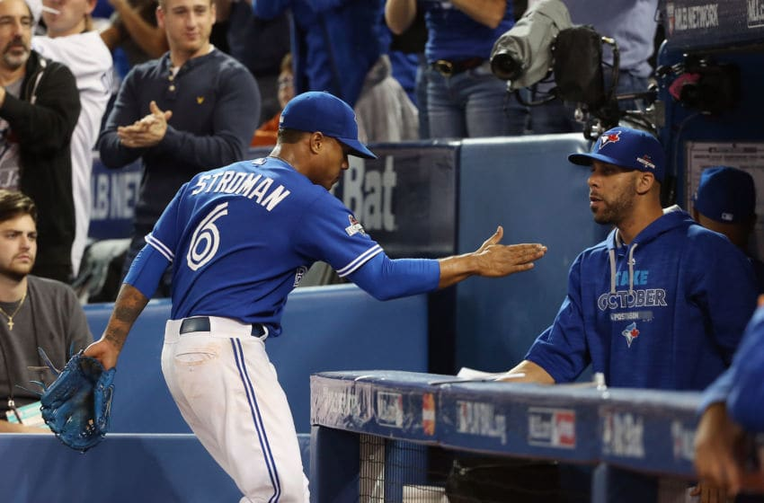 TORONTO, ON - OCTOBER 19: Marcus Stroman #6 of the Toronto Blue Jays is congratulated by David Price #14 of the Toronto Blue Jays as he is relieved in the seventh inning against the Kansas City Royals during game three of the American League Championship Series at Rogers Centre on October 19, 2015 in Toronto, Canada. (Photo by Tom Szczerbowski/Getty Images)
