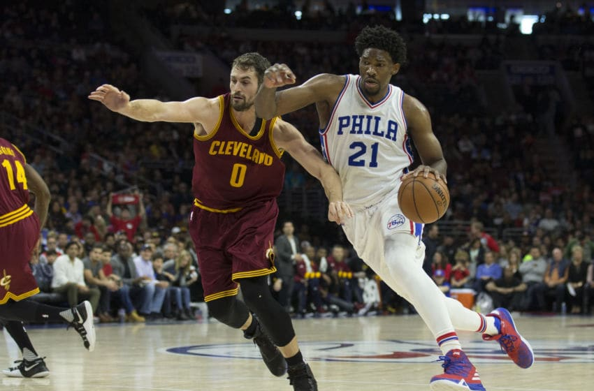 PHILADELPHIA, PA - NOVEMBER 27: Joel Embiid #21 of the Philadelphia 76ers drives to the basket against Kevin Love #0 of the Cleveland Cavaliers in the first quarter at Wells Fargo Center on November 27, 2016 in Philadelphia, Pennsylvania. NOTE TO USER: User expressly acknowledges and agrees that, by downloading and or using this photograph, User is consenting to the terms and conditions of the Getty Images License Agreement. (Photo by Mitchell Leff/Getty Images)