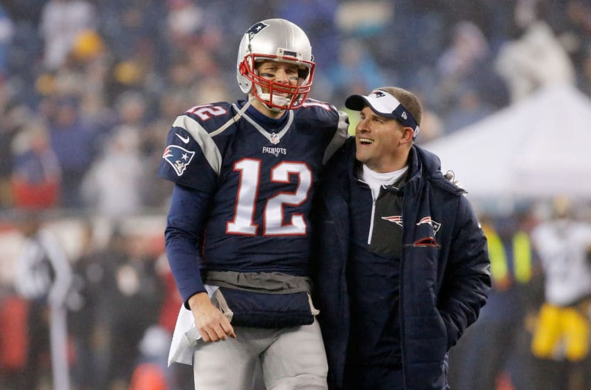 FOXBORO, MA - JANUARY 22: Tom Brady #12 of the New England Patriots talks with offensive coordinator Josh McDaniels prior to the AFC Championship Game against the Pittsburgh Steelers at Gillette Stadium on January 22, 2017 in Foxboro, Massachusetts. (Photo by Jim Rogash/Getty Images)