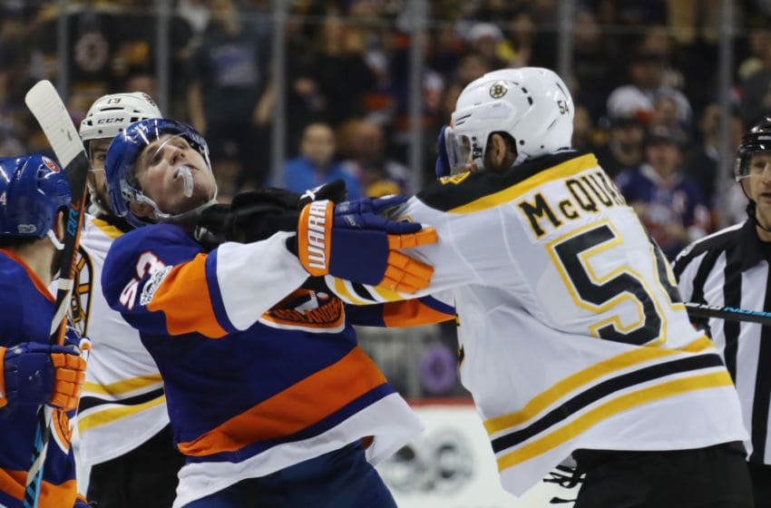 NEW YORK, NY - MARCH 25: Adam McQuaid #54 of the Boston Bruins pushes Casey Cizikas #53 of the New York Islanders during a second period scrum at the Barclays Center on March 25, 2017 in the Brooklyn borough of New York City. (Photo by Bruce Bennett/Getty Images)