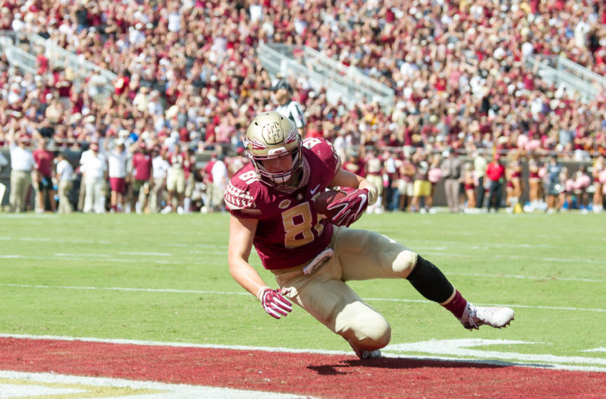 TALLAHASSEE, FL - OCTOBER 21: Tight end Ryan Izzo #81 of the Florida State Seminoles catches a pass in the enzone for a touchdown during their game against the Louisville Cardinals at Doak Campbell Stadium on October 21, 2017 in Tallahassee, Florida. (Photo by Michael Chang/Getty Images)