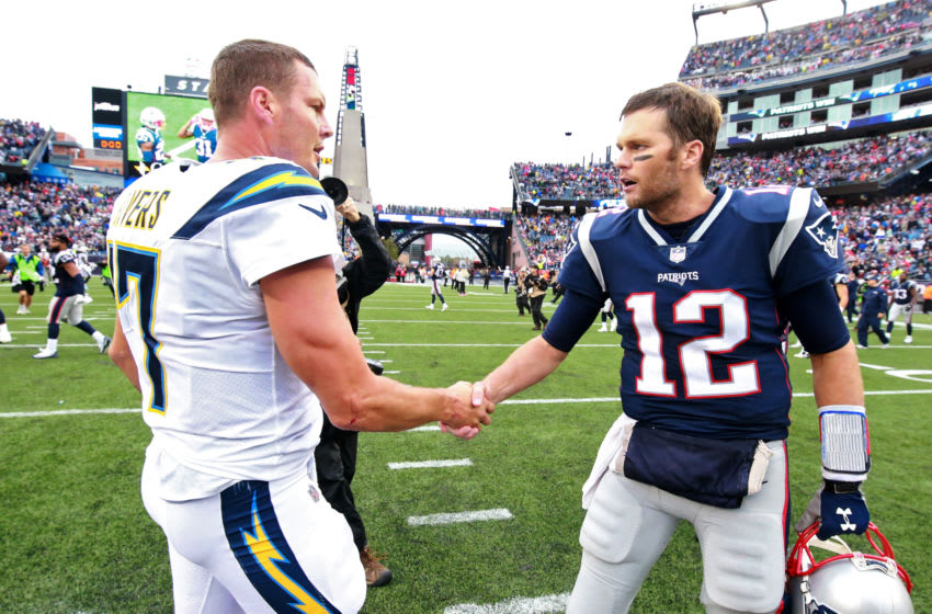 FOXBOROUGH, MA - OCTOBER 29: New England Patriots quarterback Tom Brady shakes hands with Los Angeles Chargers Philip Rivers after they defeated the Chargers 21-13 at Gillette Stadium in Foxborough, Mass., on Oct. 29, 2017. (Photo by Matthew J. Lee/The Boston Globe via Getty Images)