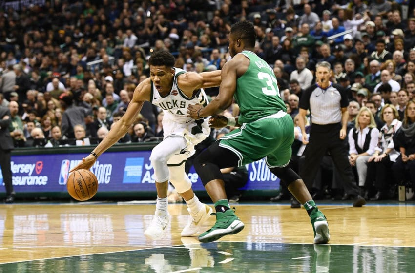 MILWAUKEE, WI - APRIL 20: Giannis Antetokounmpo #34 of the Milwaukee Bucks drives around Semi Ojeleye #37 of the Boston Celtics during the second half of game three of round one of the Eastern Conference playoffs at the Bradley Center on April 20, 2018 in Milwaukee, Wisconsin. NOTE TO USER: User expressly acknowledges and agrees that, by downloading and or using this photograph, User is consenting to the terms and conditions of the Getty Images License Agreement. (Photo by Stacy Revere/Getty Images)
