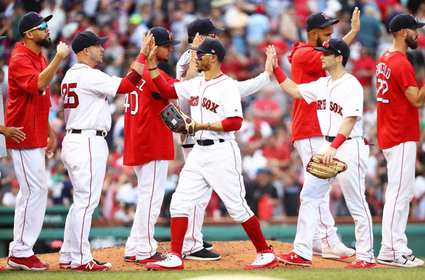 BOSTON, MA - AUGUST 04: Mookie Betts #50, Andrew Benintendi #16, Steve Pearce #25, and David Price #24 of the Boston Red Sox high five each other after a victory over the New York Yankees at Fenway Park on August 4, 2018 in Boston, Massachusetts. (Photo by Adam Glanzman/Getty Images)