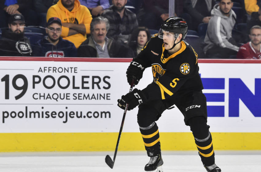 LAVAL, QC - OCTOBER 16: Urho Vaakanainen #5 of the Providence Bruins skates against the Laval Rocket at Place Bell on October 16, 2019 in Laval, Canada. The Laval Rocket defeated the Providence Bruins 5-4 in a shoot-out. (Photo by Minas Panagiotakis/Getty Images)
