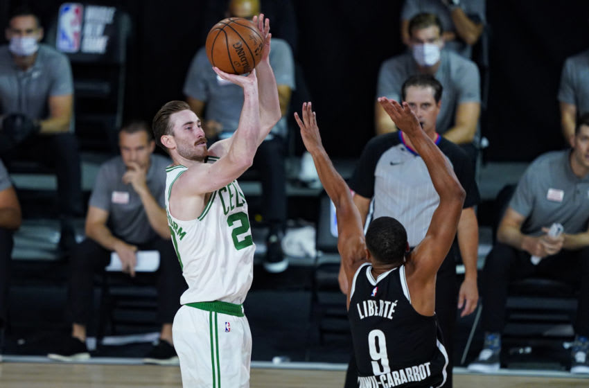 LAKE BUENA VISTA, FLORIDA - AUGUST 05: Gordon Hayward #20 of the Boston Celtics shoots over Timothe Luwawu-Cabarrot #9 of the Brooklyn Nets during the first half of an NBA basketball game at the ESPN Wide World Of Sports Complex on August 5, 2020 in Lake Buena Vista, Florida. NOTE TO USER: User expressly acknowledges and agrees that, by downloading and or using this photograph, User is consenting to the terms and conditions of the Getty Images License Agreement. (Photo by Ashley Landis-Pool/Getty Images)