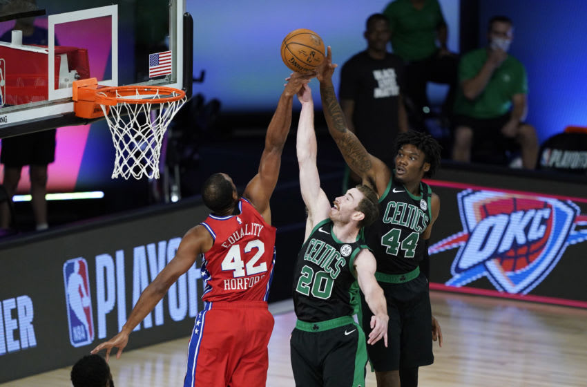 LAKE BUENA VISTA, FLORIDA - AUGUST 17: Al Horford #42 of the Philadelphia 76ers competes for a rebound against Gordon Hayward #20 and Robert Williams III #44 of the Boston Celtics during the first half at The Field House at ESPN Wide World Of Sports Complex on August 17, 2020 in Lake Buena Vista, Florida. NOTE TO USER: User expressly acknowledges and agrees that, by downloading and or using this photograph, User is consenting to the terms and conditions of the Getty Images License Agreement. (Photo by Ashley Landis - Pool/Getty Images)