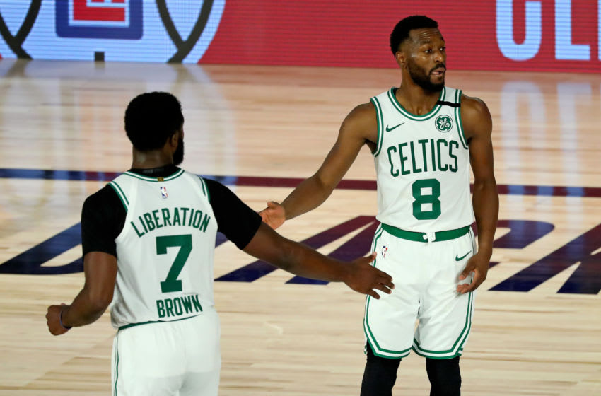 LAKE BUENA VISTA, FLORIDA - AUGUST 21: Jaylen Brown #7 and Kemba Walker #8 of the Boston Celtics celebrate a play during the second half in Game Three of the first round of the NBA Playoffs against the Philadelphia 76ers at The Field House at ESPN Wide World Of Sports Complex on August 21, 2020 in Lake Buena Vista, Florida. NOTE TO USER: User expressly acknowledges and agrees that, by downloading and or using this photograph, User is consenting to the terms and conditions of the Getty Images License Agreement. (Photo by Kim Klement - Pool/Getty Images)