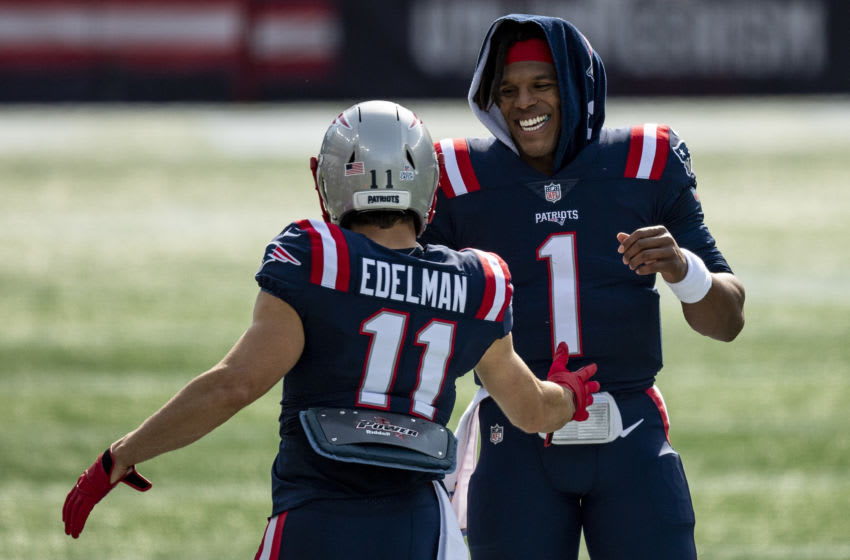 FOXBOROUGH, MA - OCTOBER 18: Cam Newton #1 of the New England Patriots reacts with Julian Edelman #11 before a game against the Denver Broncos at Gillette Stadium on October 18, 2020 in Foxborough, Massachusetts. (Photo by Billie Weiss/Getty Images)