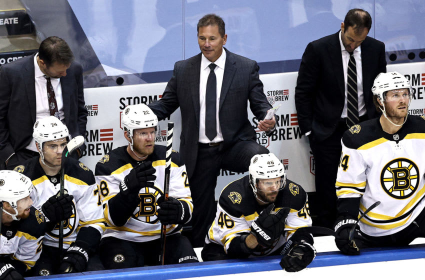 TORONTO, ONTARIO - AUGUST 15: Head coach Bruce Cassidy of the Boston Bruins reacts against the Carolina Hurricanes during the second period in Game Three of the Eastern Conference First Round during the 2020 NHL Stanley Cup Playoffs at Scotiabank Arena on August 15, 2020 in Toronto, Ontario. (Photo by Elsa/Getty Images)
