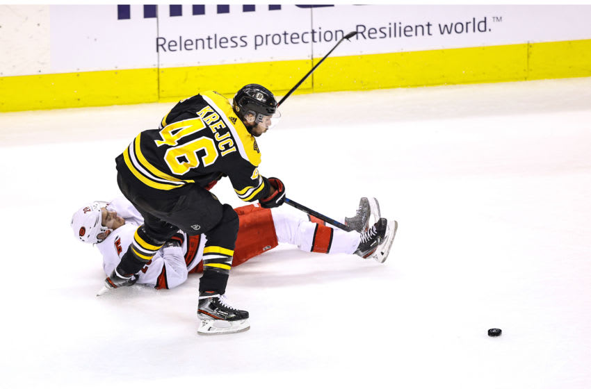 TORONTO, ONTARIO - AUGUST 19: Sebastian Aho #20 of the Carolina Hurricanes gets tripped up against David Krejci #46 of the Boston Bruins during the second period in Game Five of the Eastern Conference First Round during the 2020 NHL Stanley Cup Playoffs at Scotiabank Arena on August 19, 2020 in Toronto, Ontario. (Photo by Elsa/Getty Images)