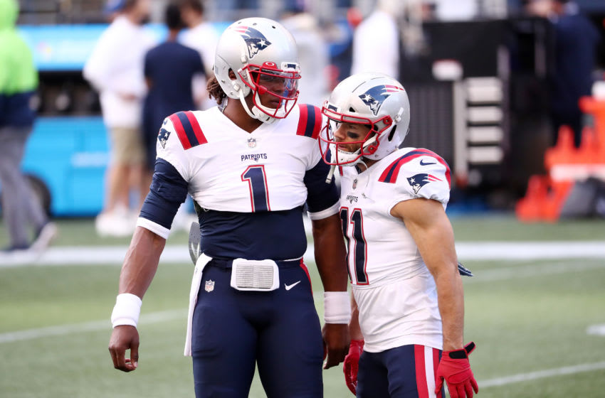 SEATTLE, WASHINGTON - SEPTEMBER 20: Cam Newton #1 of the New England Patriots talks with Julian Edelman #11 before their game against the Seattle Seahawks at CenturyLink Field on September 20, 2020 in Seattle, Washington. (Photo by Abbie Parr/Getty Images)