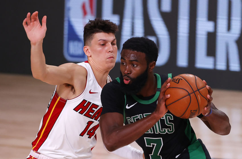 LAKE BUENA VISTA, FLORIDA - SEPTEMBER 25: Tyler Herro #14 of the Miami Heat defends Jaylen Brown #7 of the Boston Celtics during the first quarter against the Boston Celtics in Game Five of the Eastern Conference Finals during the 2020 NBA Playoffs at AdventHealth Arena at the ESPN Wide World Of Sports Complex on September 25, 2020 in Lake Buena Vista, Florida. NOTE TO USER: User expressly acknowledges and agrees that, by downloading and or using this photograph, User is consenting to the terms and conditions of the Getty Images License Agreement. (Photo by Mike Ehrmann/Getty Images)