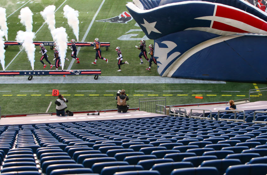 FOXBOROUGH, MASSACHUSETTS - OCTOBER 25: The New England Patriots run out onto the field before the game against the San Francisco 49ers at Gillette Stadium on October 25, 2020 in Foxborough, Massachusetts. (Photo by Maddie Meyer/Getty Images)