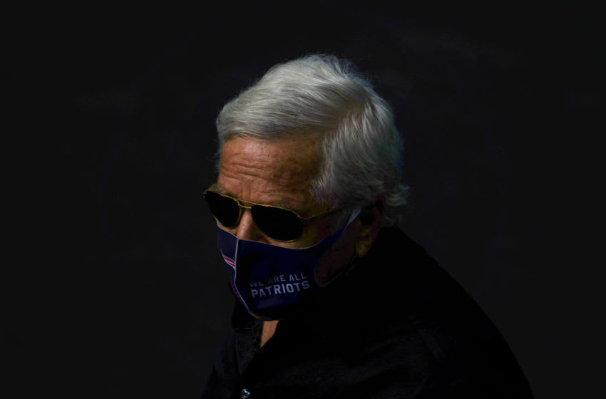 MIAMI GARDENS, FLORIDA - DECEMBER 20: Robert Kraft Chairman & CEO of the New England Patriots wears a mask while heading to the field prior to the game against the Miami Dolphins at Hard Rock Stadium on December 20, 2020 in Miami Gardens, Florida. (Photo by Mark Brown/Getty Images)