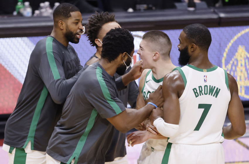 MIAMI, FLORIDA - JANUARY 06: Payton Pritchard #11 of the Boston Celtics celebrates with his teammates after making a game-winning layup with 0.2 seconds remaining against the Miami Heat during the fourth quarter at American Airlines Arena on January 06, 2021 in Miami, Florida. NOTE TO USER: User expressly acknowledges and agrees that, by downloading and or using this photograph, User is consenting to the terms and conditions of the Getty Images License Agreement. (Photo by Michael Reaves/Getty Images)