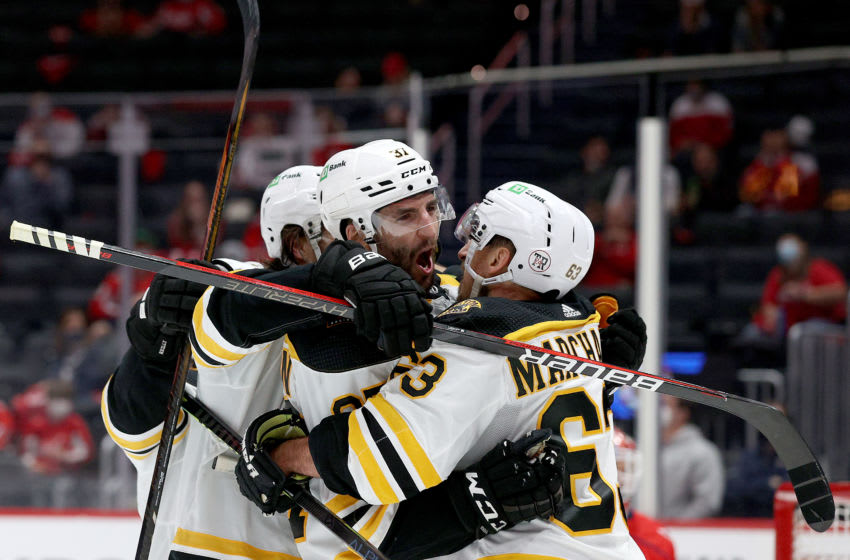 WASHINGTON, DC - MAY 23: Patrice Bergeron #37 of the Boston Bruins celebrates a third period goal with Brad Marchand #63 against the Washington Capitals during Game Five of the 2021 Stanley Cup Playoffs at Capital One Arena on May 23, 2021 in Washington, DC. (Photo by Rob Carr/Getty Images)