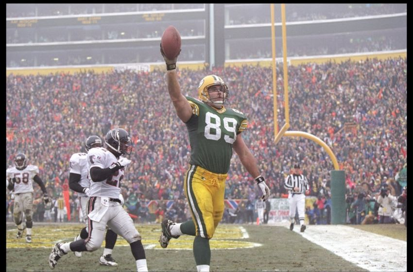 31 Dec 1995: Tight end Mark Chmura of the Green Bay Packes celebrates after scoring a touchdown against the Atlanta Falcons at Lambeau Field in Green Bay, Wisconsin. The Packers won the game 37-20. Mandatory Credit: Brian Bahr /Allsport