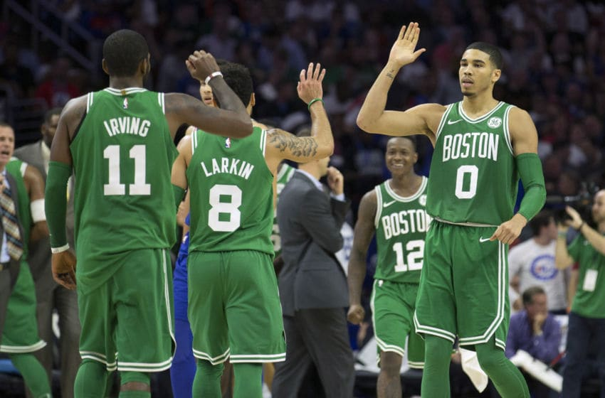 PHILADELPHIA, PA - OCTOBER 20: Jayson Tatum #0 of the Boston Celtics high fives Kyrie Irving #11 and Shane Larkin #8 in the fourth quarter against the Philadelphia 76ers at the Wells Fargo Center on October 20, 2017 in Philadelphia, Pennsylvania. The Celtics defeated the 76ers 102-92. NOTE TO USER: User expressly acknowledges and agrees that, by downloading and or using this photograph, User is consenting to the terms and conditions of the Getty Images License Agreement. (Photo by Mitchell Leff/Getty Images)
