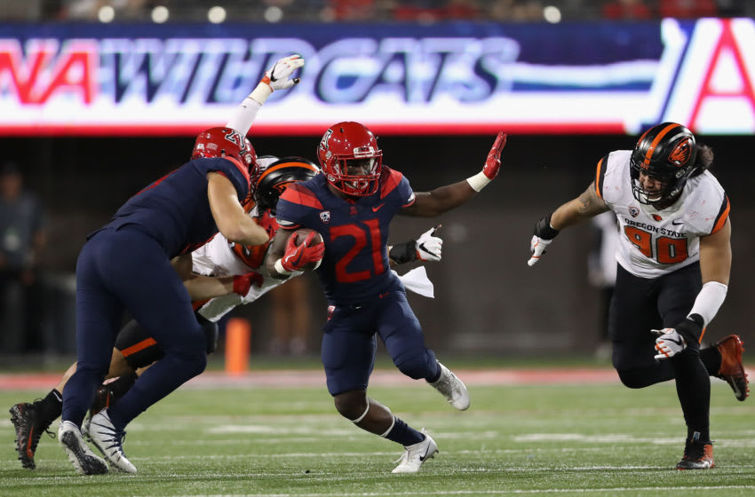 TUCSON, AZ - NOVEMBER 11: Running back J.J. Taylor #21 of the Arizona Wildcats rushes the football against the Oregon State Beavers during the second half of the college football game at Arizona Stadium on November 11, 2017 in Tucson, Arizona. (Photo by Christian Petersen/Getty Images)