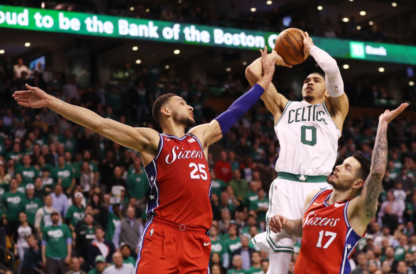BOSTON, MA - APRIL 30: Jayson Tatum #0 of the Boston Celtics takes a shot over Ben Simmons #25 of the Philadelphia 76ers and JJ Redick #17 during the second half of Game One in Round Two of the 2018 NBA Playoffs at TD Garden on April 30, 2018 in Boston, Massachusetts. The Celtics defeat the 76ers 117-101. (Photo by Maddie Meyer/Getty Images)