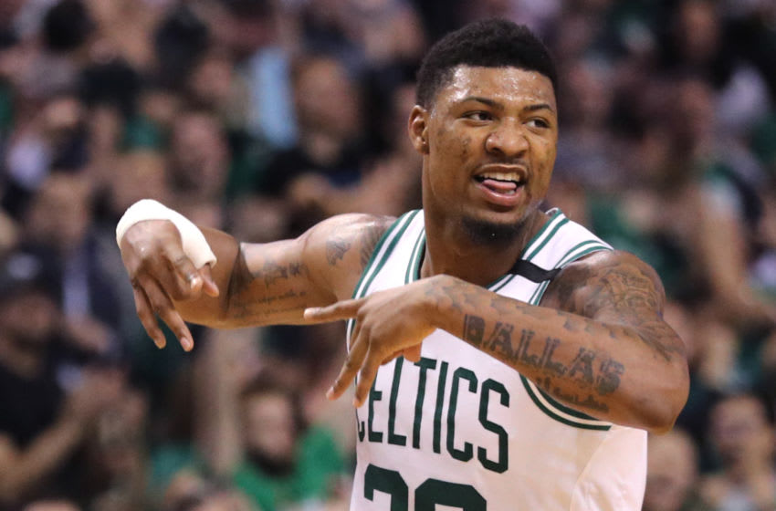 BOSTON, MA - MAY 3: Marcus Smart #36 of the Boston Celtics celebrates after hitting a three point shot against the Philadelphia 76ers during the second quarter of Game Two of the Eastern Conference Second Round of the 2018 NBA Playoffs at TD Garden on May 3, 2018 in Boston, Massachusetts. (Photo by Maddie Meyer/Getty Images)