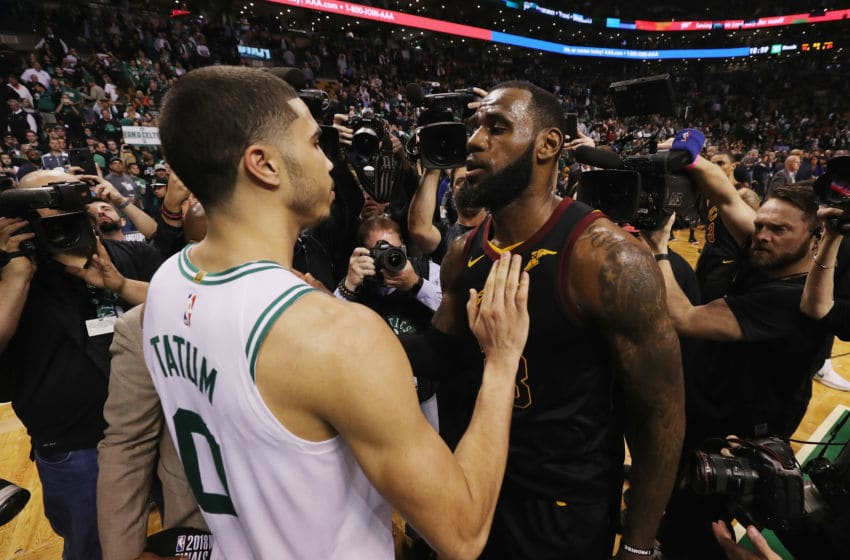 BOSTON, MA - MAY 27: LeBron James #23 of the Cleveland Cavaliers talks with Jayson Tatum #0 of the Boston Celtics after the Cleveland Cavaliers defeated the Boston Celtics 87-79 in Game Seven of the 2018 NBA Eastern Conference Finals to advance to the 2018 NBA Finals at TD Garden on May 27, 2018 in Boston, Massachusetts. NOTE TO USER: User expressly acknowledges and agrees that, by downloading and or using this photograph, User is consenting to the terms and conditions of the Getty Images License Agreement. (Photo by Maddie Meyer/Getty Images)