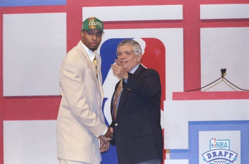 25 Jun 1997: Forward Ron Mercer of the Boston Celtics shakes hands with NBA Commissioner David Stern during the NBA Draft at the Charlotte Coliseum in Charlotte, North Carolina. Mandatory Credit: Craig Jones /Allsport