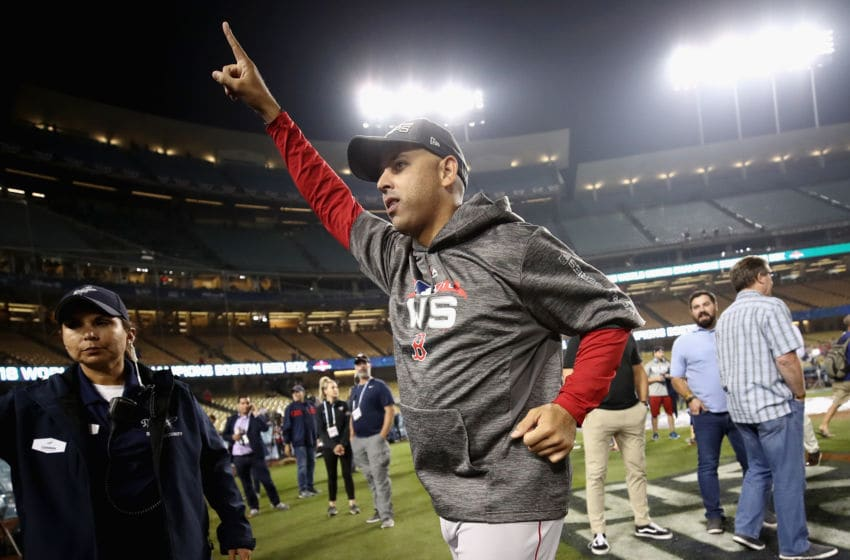 LOS ANGELES, CA - OCTOBER 28: Alex Cora #20 of the Boston Red Sox celebrates his team's 5-1 win over the Los Angeles Dodgers in Game Five of the 2018 World Series at Dodger Stadium on October 28, 2018 in Los Angeles, California. (Photo by Ezra Shaw/Getty Images)