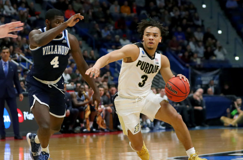 HARTFORD, CONNECTICUT - MARCH 23: Carsen Edwards #3 of the Purdue Boilermakers is defended by Eric Paschall #4 of the Villanova Wildcats in the second half during the second round of the 2019 NCAA Men's Basketball Tournament at XL Center on March 23, 2019 in Hartford, Connecticut. (Photo by Maddie Meyer/Getty Images)