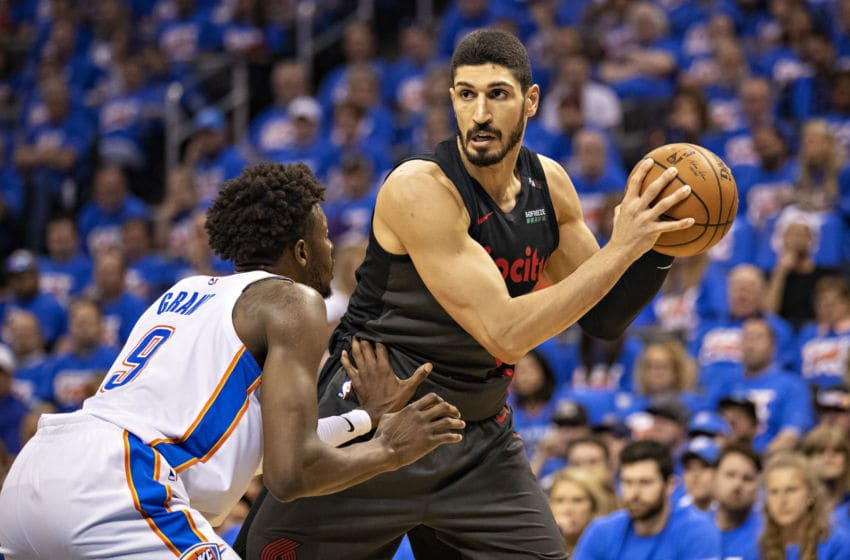 OKLAHOMA CITY, OK - APRIL 21: Enes Kanter #00 of the Portland Trail Blazers with the ball being defended by Jerami Grant #9 of the Oklahoma City Thunder during Round One Game Three of the 2019 NBA Playoffs on April 21, 2019 at Chesapeake Energy Arena in Oklahoma City, Oklahoma NOTE TO USER: User expressly acknowledges and agrees that, by downloading and or using this photograph, User is consenting to the terms and conditions of the Getty Images License Agreement. The Trail Blazers defeated the Thunder 111-98. (Photo by Wesley Hitt/Getty Images)