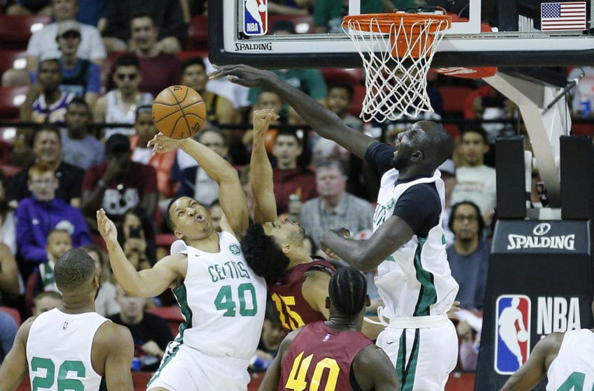 LAS VEGAS, NEVADA - JULY 08: Grant Williams #40 and Tacko Fall #55 of the Boston Celtics block a shot by Naz Mitrou-Long #15 of the Cleveland Cavaliers during the 2019 NBA Summer League at the Thomas & Mack Center on July 08, 2019 in Las Vegas, Nevada. NOTE TO USER: User expressly acknowledges and agrees that, by downloading and or using this photograph, User is consenting to the terms and conditions of the Getty Images License Agreement. (Photo by Michael Reaves/Getty Images)