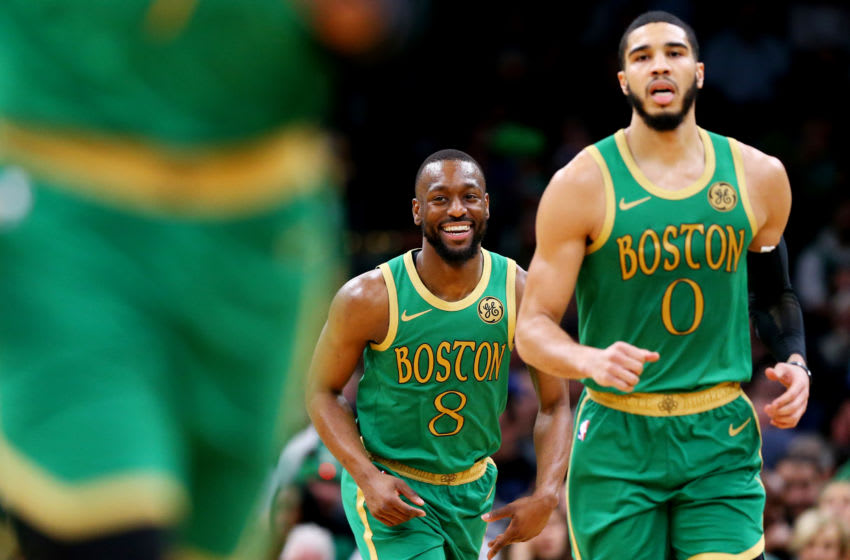 BOSTON, MASSACHUSETTS - DECEMBER 12: Kemba Walker #8 of the Boston Celtics smiles during the game against the Philadelphia 76ers at TD Garden on December 12, 2019 in Boston, Massachusetts. NOTE TO USER: User expressly acknowledges and agrees that, by downloading and or using this photograph, User is consenting to the terms and conditions of the Getty Images License Agreement. (Photo by Maddie Meyer/Getty Images)